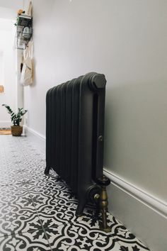 Ribbles Reclaimed Radiator In Pewter - Utility And Boot Room With Down Pipe Painted Custom Tiles And Patterned Tile Floor. Victorian Radiators, Future House, Victorian Hallway, Tiled Hallway, Black Hallway, Hall Flooring, Hallway Inspiration, Hallway Designs, Hallway Ideas