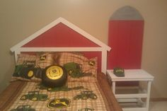 My son loves John Deere, so I commissioned my husband to build a barn bed and silo side table to compliment his tractor bedding. :)