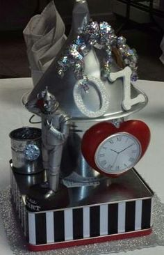 Tin Man Centerpiece Wizard Of Oz Musical, Wizard Of Oz Decor, Cowardly Lion, Land Of Oz, Tin Man, Visiting Teaching, Wicked Witch, Emerald City, Party Centerpieces