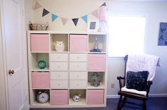 Baby girl nursery~ Love this shelfing unit.  It'd be cute for a boy too with blue knobs & blue baskets