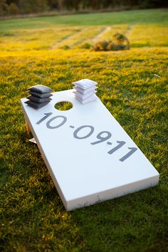 bean bag toss boards with wedding date | yard games | photo: Summer Street Photography