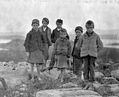 Poolewe is situated at the head of Loch Ewe near Gairloch. This photograph shows a group of young children from the Poolewe area. Many children in the Highlands, up until the early 20th century, only wore shoes on special occasions and in winter.