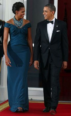 We love Mrs. Obama's teal gown that she wore to the White House state dinner but it's the statement necklace that steals the shine. The piles of pretty pearls are classic with a twist. http://bit.ly/wHiEXZ