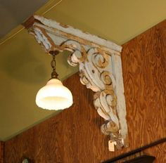 Junkyjoey  A salvaged corbel is used to hang a light....really adds character!