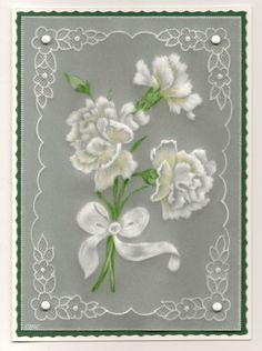 By Carolyn C.  Parchment card coloured with polychromo pencils. Carnations in border.