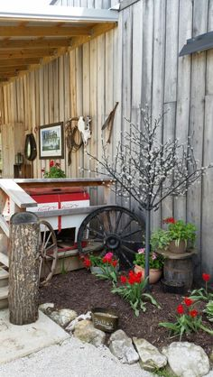 The deck and some Court yard flowers at the barn venue at Rocking J Ranch in High Ridge.