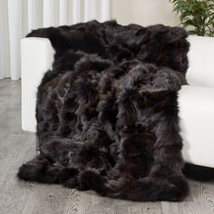 d03985cf08 The brown fox fur blanket throw is luxuriously lush and soft. It is  professionally