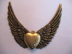 Gold Toned Winged Locket Pendant.