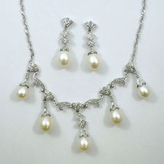 Five Pearl Necklace with Accent Diamonds with Matching Pearl and Diamond Earrings. Set in 14K White Gold.  - $1250