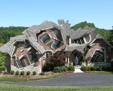"""altered photo series """"Deconstructing the Houses,"""" large suburban homes appear fragmented and jumbled, almost as if they are falling down. The images"""