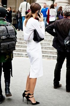 Chic all white outfit + low ponytail and killer black heels