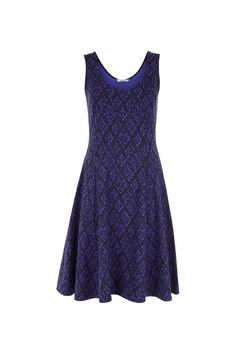 Blue sleeveless dress with abstract print in 95% organic certified cotton, 5% elastane. Sleeveless jersey dress with side pockets. Length 100cm.