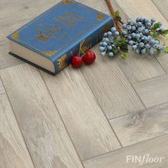 Finfloor - Authentic Herringbone laminate colour Bleached Beech.