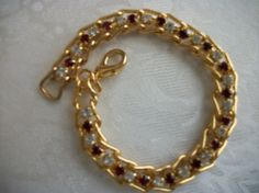 SOLD - Vintage Ruby Red & Clear Rhinestone Tennis by PhylmasFabulousFinds, $25.00 - SOLD