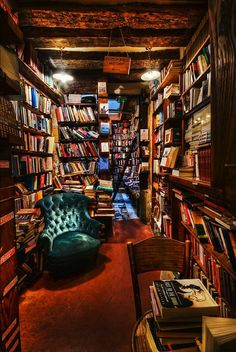 Books everywhere and one perfect reading chair.. just needs an ottoman, snuggley blanket, and a cat