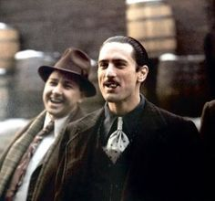 Robert De Niro as Young Vito Corleone and Bruno Kirby as Young Clemenza behind the scenes of The Godfather Part II. Corleone Family, Don Corleone, The Godfather Part Ii, Godfather Movie, Godfather Quotes, Andy Garcia, Al Pacino, Marlon Brando, The Best Films