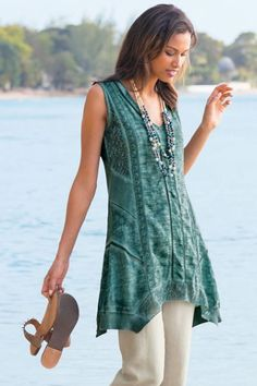 Our Ocean Fade Tunic has a lovely mix of materials and textures for a singularly spectacular style. Available in three washed jewel tone colors.