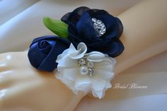 This is a beautiful triple flower wrist corsage. Flowers are made from chiffon and satin fabrics. and embellished with rhinestones and