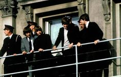 The Beatles on a fire escape of the Clarendon Hotel, Christchurch, in June 1964, where they avoided being pelted with eggs.