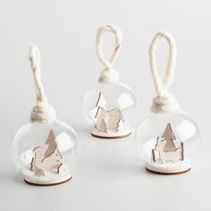 Our handcrafted set of glass snow globe ornaments depict pastoral winter scenes of laser cut wood. The frosty set of three includes a squirrel, a deer and a fox in the white woods.