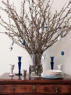 Spring twigs, decorated eggs, and crystal beads hung with twine make the home Easter ready.