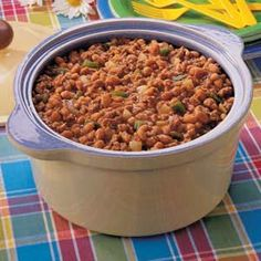 Pork 'n' Beans with ground beef is a very easy and delicious meal. It is also very flexible and can be varied in many different ways. Top some rice with this and the family will be happy.