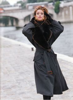 Susan Holmes, in early 90s trench coat