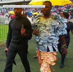 South African Herbalist Walks Around Literally Dressed in Money - http://www.odditycentral.com/news/south-african-herbalist-walks-around-literally-dressed-in-money.html