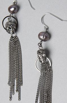 The Pirates Of The Caribbean Skull and Pearl Earrings