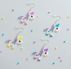 Bubblegum Unicorn Hama Bead Earrings is part of Unicorn crafts Colour Perler beads and silverplated earring hooks, with a rubber stopper on the back Both sides have been ironed for strength Colou - Mini Hama Beads, Diy Perler Beads, Perler Bead Art, Pearler Beads, Fuse Beads, Hama Beads Kawaii, Perler Bead Designs, Hama Beads Design, Pearler Bead Patterns