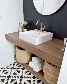 Half bathroom ideas and they're perfect for guests. They don't have to be as functional as the family bathrooms, so hope you enjoy these ideas. Update your bathroom decor quickly with these budget-friendly, charming half bathroom ideas # bathroom Modern Farmhouse Bathroom, Wooden Bathroom, Basement Bathroom, White Bathroom, Bathroom Flooring, Bathroom Storage, Bathroom Interior, Farmhouse Decor, Design Bathroom