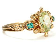 Strike It Rich: Antique Peridot & Emerald Ring