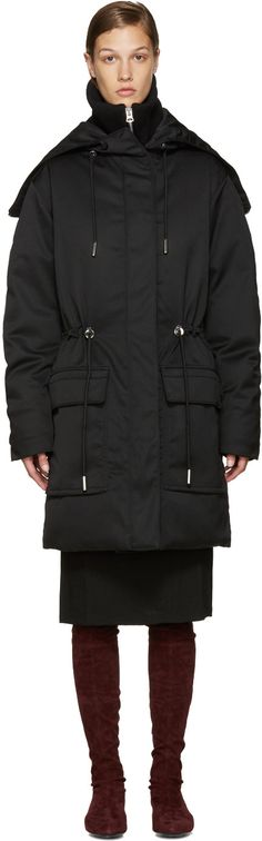 Long sleeve hooded down coat in black. Oversized fit. Zipper at top of hood…