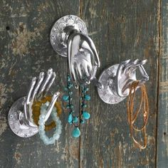 Mudras, or nonverbal finger communications, play a central role in #Buddhism. They symbolize wisdom, reason and fearlessness - all while collecting and organizing your jewelry in the form of three graceful recycled metal hands that are easily mounted on a wall