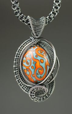 Silver wire woven pendant with lampwork bead by DesignsByKaska