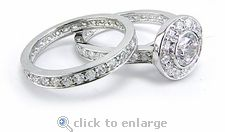 Ziamond cubic zirconia round bezel set halo wedding set in 14k white gold.  The Eternal Love Bridal Set features a matching eternity band to compliment the solitaire. #ziamond #cubiczirconia #halo #bridal #eternity #wedding #14kgold