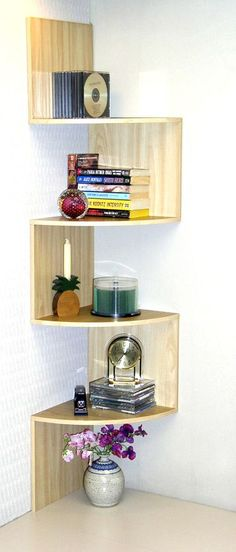 Hanging Corner Storage The maple corner staggered bookshelf is a fun way to add sculptural appeal and function. It's a great choice for organizing and takes advantage of hard-to-fill space.