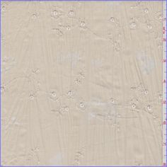 Biscotti tan with a burnout floral design thathas a tone on tone embroidered floral eyelet accent. This soft, lightweight cotton and polyester blend fabric has a crinkled surface.Compare to $12.00/yd
