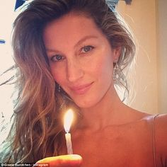 'May this New Year bring you amazing opportunities': Gisele Instagrammed a glowing selfie on New Year's Eve, while holding a candle, as she wished everyone well