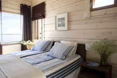 A fresh combination of blue and brown with wood. Honka log homes.