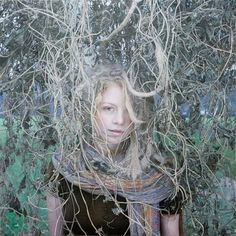 Hyperrealistic female portrait painted in oil by Israeli artist Yigal Ozeri