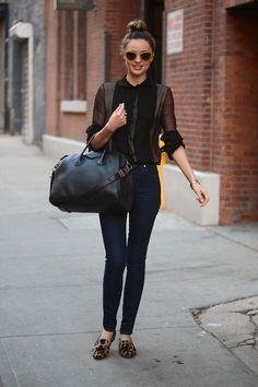 adore. Skinny jeans, flats, black sheer top, top knot