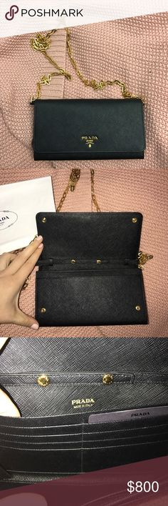 """Prada Saffiano Leather Chain Wallet Never used! Beautiful Prada Chain Wallet. Gold hardware & leather are in perfect condition - selling because I received something similar for my birthday! It includes a removable chain crossbody strap, 22"""" drop, snap flap closure, 3 inside open pockets (fits iPhone + sizes!), 3 inside credit card slots with Nappa leather lining. Saffiano leather, Made in Italy. Can be worn/used as a crossbody/shoulder bag, wallet & clutch :) I will consider serious offers…"""