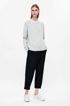 This jumper is made from pure cashmere with an extra-soft, fuzzy feel. A relaxed shape and style, it has a simple round neckline, ribbed edges and long raglan sleeves.