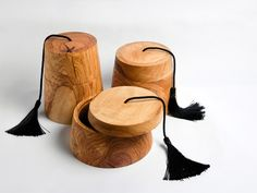 GIFL - Olivewood  More Corfu town than Tinseltown. A series of fez - shaped containers as well as a pair of Greekified dutch clogs, all hand-tooled in sustainable Corfiot olivewood.