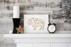 Make this Gold Glitter Geometric Buffalo art as a great piece of DIY decor. Perfect for nurseries and other quirky spaces!