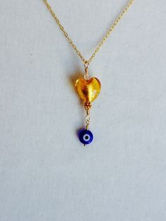 Heart of Gold with an Evil Eye Pendant by RoughCutStoneJewelry on Etsy