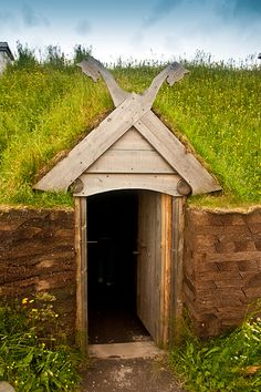 UNESCO World Heritage Site.                             Longhouse at l'Anse aux Meadows, Newfoundland, CANADA