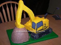 Homemade Excavator Cake: I made this Excavator cake for my friend's son's 2nd B-Day....he loves diggies! The base of the machine is a 12x18 vanilla pound cake that I cut and carved