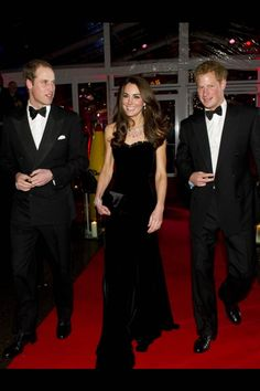 Prince William, Duke of Cambridge, Catherine, Duchess of Cambridge wearing Alexander McQueen and Prince Harry attend The Sun Military Awards at Imperial War Museum on December 19, 2011 in London, England.